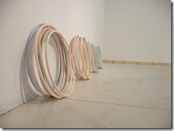 Maya Muchawsky Parnas '40 Hula Hoops', 2012, slip-cast earthenware, 40 units, d. approx. 60 cm each; photo by Orly Nezer