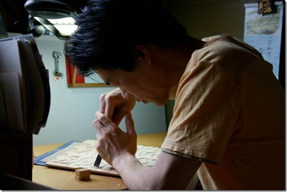 Carver Kitamura Shōichi works through a stage of the woodcutting process for one of the four blocks that will capture a single original painting by Salter.